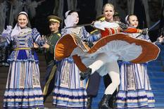 Members of Russian ensemble perform a traditional Cossack's dance with swords during the opening ceremony of the 3rd Krasnoyarsk Asian-Pacific International musical festival in the Siberian city of Krasnoyarsk, in this file photo taken June 29, 2012. REUTERS/Ilya Naymushin/Files