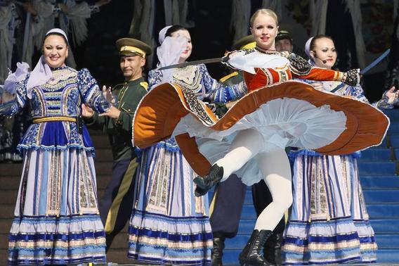 Members of Russian ensemble perform a traditional Cossack's dance with swords during the opening ceremony of the 3rd Krasnoyarsk Asian-Pacific International musical festival in the Siberian city of Krasnoyarsk, in this file photo taken June 29, 2012. REUTERS-Ilya Naymushin-Files