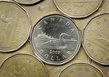 A Canadian one dollar coin, also know as a loonie, is shown in Montreal, April 28, 2006.  REUTERS/Shaun Best