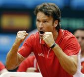 Spain's team captain Carlos Moya reacts during the Davis Cup play-offs tennis match between Thomaz Bellucci of Brazil and Roberto Bautista of Spain in Sao Paulo September 14, 2014. REUTERS/Paulo Whitaker