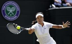 Li Na of China hits a return to Barbora Strycova of the Czech Republic during their women's singles tennis match at the Wimbledon Tennis Championships, in London June 27, 2014.   REUTERS/Max Rossi/Files