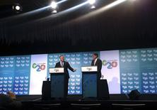 U.S. Treasury Secretary Jack Lew (R) stands with his Australian counterpart Joe Hockey during a media conference at the start of the G20 Finance Ministers and Central Bank Governors meeting in the northern Australian city of Cairns September 19, 2014.  REUTERS/Lincoln Feast
