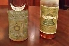 Rare bottles of Belmont (R) and Cascade Kentucky bourbon are seen at the Filson Historical Society in Louisville, Kentucky September 19, 2014. REUTERS/Steve Bittenbender