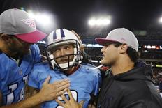 Tennessee Titans' Rusty Smith (L) celebrates with kicker Rob Bironas (C) after Bironas kicked a 40-yard field goal to lead the Titans to a win in the last seconds of their NFL football game against the Pittsburgh Steelers in Nashville, Tennessee October 11, 2012.  REUTERS/Harrison McClary