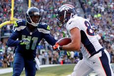 Denver Broncos tight end Jacob Tamme (84) catches a touchdown against Seattle Seahawks cornerback Byron Maxwell (41) during the fourth quarter at CenturyLink Field. Mandatory Credit: Joe Nicholson-USA TODAY Sports