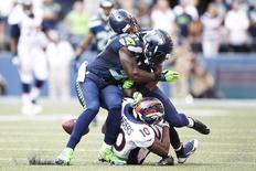 Sep 21, 2014; Seattle, WA, USA; Seattle Seahawks strong safety Kam Chancellor (31) and defensive back Marcus Burley (28) break up a pass intended for Denver Broncos wide receiver Emmanuel Sanders (10) during the fourth quarter at CenturyLink Field. Joe Nicholson-USA TODAY Sports - RTR475R6