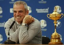 Europe Ryder Cup captain Paul McGinley smiles as he sits with the Ryder Cup during a news conference ahead of the 2014 Ryder Cup at Gleneagles in Scotland September 22, 2014.  REUTERS/Phil Noble