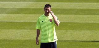 Jogador do Barcelona Lionel Messi treina na Ciutat Esportiva Joan Gamper, em Sant Joan Despi, perto de Barcelona. 16/9/2014 REUTERS/Gustau Nacarino