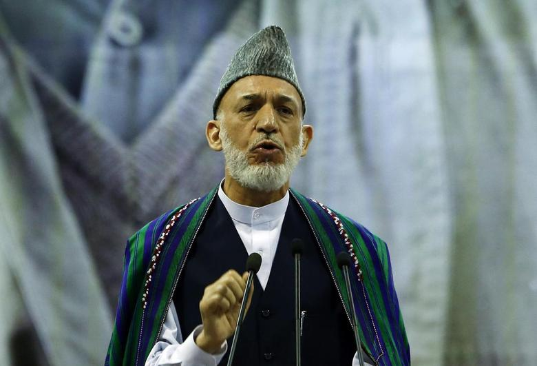 Outgoing Afghan President Hamid Karzai speaks during a ceremony commemorating the 2001 assassination of legendary Tajik resistance commander Ahmad Shah Massoud, in Kabul Septembsr 9, 2014.  REUTERS/Omar Sobhani