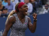 Serena Williams of the U.S. celebrates a point against Caroline Wozniacki of Denmark during their women's singles finals match at the 2014 U.S. Open tennis tournament in New York, September 7, 2014.  REUTERS/Mike Segar