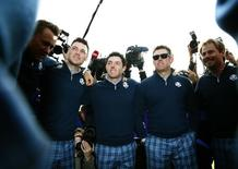 European Ryder Cup players (L-R) Ian Poulter, Martin Kaymer, Rory McIlroy, Lee Westwood and Victor Dubuisson pose together ahead of the 2014 Ryder Cup at Gleneagles in Scotland September 23, 2014. REUTERS/Eddie Keogh