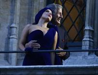 Lady Gaga and Tony Bennett pose on the balcony of Brussels townhall after a news conference, September 22, 2014.  REUTERS/Yves Herman