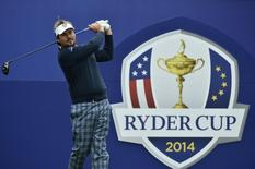 European Ryder Cup player Victor Dubuisson watches his tee shot on the first hole during practice ahead of the 2014 Ryder Cup at Gleneagles in Scotland September 23, 2014.  REUTERS/Toby Melville