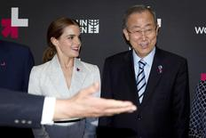 Actress Emma Watson (L) and United Nations Secretary General Ban Ki-moon are shown the way to the exit following a photo opportunity promoting the HeForShe campaign in New York September 20, 2014.  REUTERS/Carlo Allegri