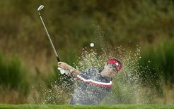 U.S. Ryder Cup player Bubba Watson hits from a bunker on the ninth hole during practice ahead of the 2014 Ryder Cup at Gleneagles in Scotland September 23, 2014. REUTERS/Phil Noble