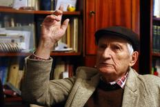 Valentin Cristea, 84, believed to be the only survivor still alive from the communist-era Ramnicu Sarat prison in eastern Romania, gestures during an interview with Reuters in Campina September 23, 2014. REUTERS/Bogdan Cristel