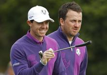 European Ryder Cup players Rory McIlroy (L) and Graeme McDowell walk off the 17th tee during practice ahead of the 2014 Ryder Cup at Gleneagles in Scotland September 24, 2014. REUTERS/Phil Noble