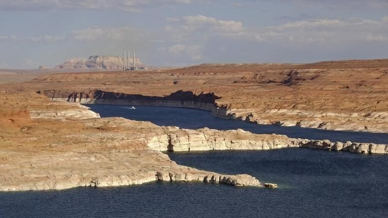 View of lake Powell and the Navajo power generating station (background) near Page, Arizona August 12, 2012. REUTERS/Charles Platiau
