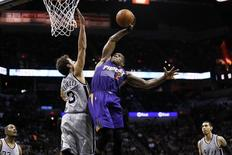 Apr 11, 2014; San Antonio, TX, USA; Phoenix Suns guard Eric Bledsoe (2) dunks over San Antonio Spurs forward Marco Belinelli (3) during the second half at AT&T Center.  Soobum Im-USA TODAY Sports