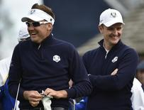European Ryder Cup players Ian Poulter (L) and  Justin Rose laugh as they wait on the third tee during practice ahead of the 2014 Ryder Cup at Gleneagles in Scotland September 25, 2014.  REUTERS/Toby Melville