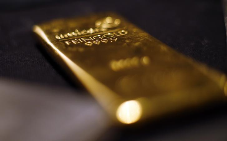 Gold bars are stacked at a safe deposit room of the ProAurum gold house in Munich March 6, 2014.REUTERS/Michael Dalder