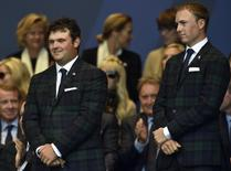 Team U.S. players Patrick Reed (L) and Jordan Speith stand during the opening ceremony for the 40th Ryder Cup at Gleneagles in Scotland September 25, 2014.  REUTERS/Toby Melville