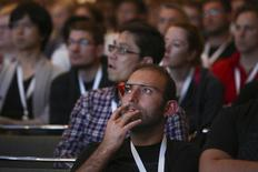 A Google Glass-wearing attendee listens to a speaker in the 'Designing for Wearables' session at the Google I/O developers conference in San Francisco June 25, 2014.  REUTERS/Elijah Nouvelage