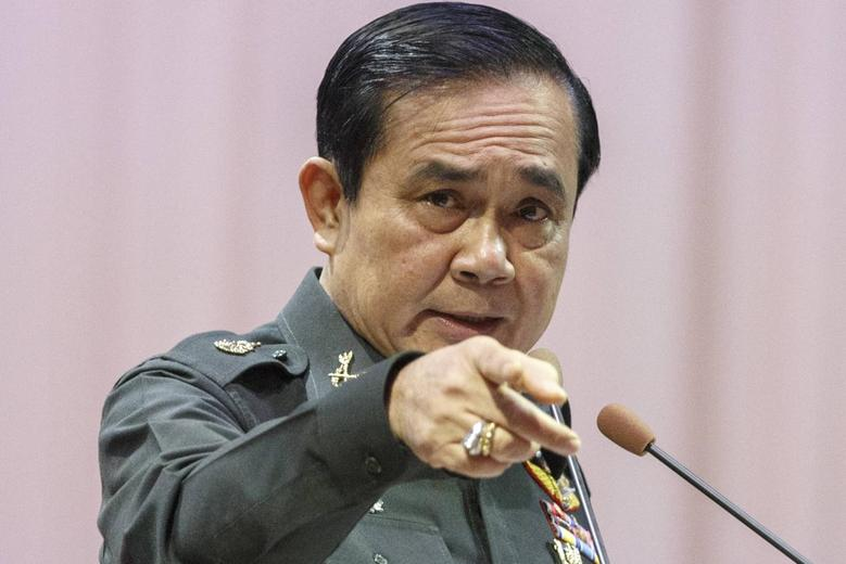 Thailand's Prime Minister Prayuth Chan-ocha gestures as he speaks during an event titled ''The Instruction on the Procedures of Members of the National Reform Council'' at the Army Club in Bangkok September 4, 2014. REUTERS/Athit Perawongmetha