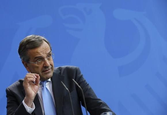 Greek Prime Minister Antonis Samaras addresses a joint news conference with German Chancellor Angela Merkel in Berlin September 23, 2014. REUTERS/Fabrizio Bensch