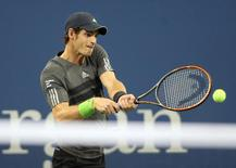 Sep 3, 2014; New York, NY, USA; Andy Murray (GBR) returns a shot to Novak Djokovic (SRB) on day ten of the 2014 U.S. Open tennis tournament at USTA Billie Jean King National Tennis Center. Mandatory Credit: Jerry Lai-USA TODAY Sports