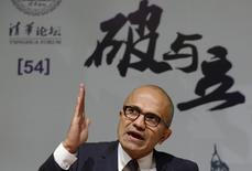 Microsoft Chief Executive Satya Nadella gestures as he speaks during a forum at Tsinghua University in Beijing September 25, 2014. REUTERS/China Daily