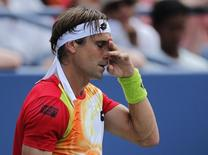 David Ferrer of Spain reacts after a missed return to Gilles Simon of France during their match at the 2014 U.S. Open tennis tournament in New York, August 31, 2014.  REUTERS/Eduardo Munoz
