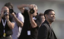 """Актёр Дензел Вашингтон на кинофестивале в Сан-Себастьяне 19 сентября 2014 года. Триллер """"Великий уравнитель"""" в Дензелом Вашингтоном возглавил кинопрокат Северной Америки по итогам прошедших выходных. REUTERS/Vincent West"""