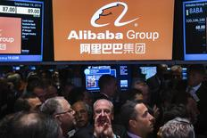 "Traders work on the floor as they wait for a final price on the Alibaba Group Holding Ltd. initial public offering (IPO) under the ticker ""BABA"", at the New York Stock Exchange in New York September 19, 2014.  REUTERS/Lucas Jackson"