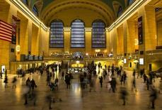 Travelers and commuters walk through Grand Central Station in New York November 27, 2013. REUTERS/Eric Thayer