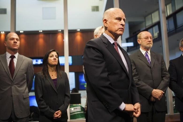 California Governor Jerry Brown (front) waits to speak at a news conference at the Cal OES State Operations Center in Mather, California, February 19, 2014.  REUTERS/Max Whittaker