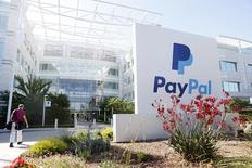 A PayPal sign is seen at an office building in San Jose, California May 28, 2014. REUTERS/Beck Diefenbach