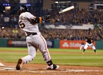 Oct 1, 2014; Pittsburgh, PA, USA; San Francisco Giants shortstop Brandon Crawford (35) hits a grand slam home run against the Pittsburgh Pirates during the fourth inning of the 2014 National League Wild Card playoff baseball game at PNC Park. Charles LeClaire-USA TODAY Sports