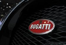 A Bugatti hood ornament logo is pictured at the Jacob Javits Convention Center during the New York International Auto Show in New York April 17, 2014.  REUTERS/Carlo Allegri