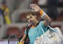 Rafael Nadal of Spain waves after losing to Martin Klizan of Slovakia during their men's quarter-final match at the China Open tennis tournament in Beijing, October 3, 2014. REUTERS/Jason Lee