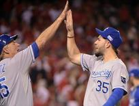 Oct 3, 2014; Anaheim, CA, USA; Kansas City Royals first baseman Eric Hosmer (35) celebrates with first base coach Rusty Kuntz (15) after defeating the Los Angeles Angels in game two of the 2014 ALDS playoff baseball game at Angel Stadium of Anaheim. Mandatory Credit: Kirby Lee-USA TODAY Sports