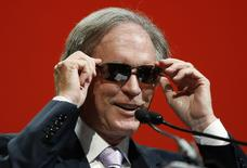 Bill Gross, co-founder and co-chief investment officer of Pacific Investment Management Company (PIMCO), adjusts his sunglasses as he arrives to speak at the Morningstar Investment Conference in Chicago, Illinois, June 19, 2014.   REUTERS/Jim Young
