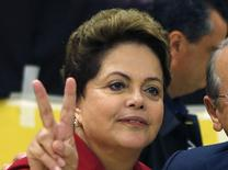 Brazil's President and Workers' Party (PT) candidate for re-election, Dilma Rousseff, gestures to photographers after voting in the first round election in Port Alegre, October 5, 2014.   REUTERS/Paulo Whitaker (BRAZIL - Tags: POLITICS ELECTIONS)