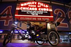 T.C. O'Rourke sits in his pedicab outside Wrigley Field in the Wrigleyville neighborhood in Chicago, Illinois, September 19, 2014.  REUTERS/Jim Young