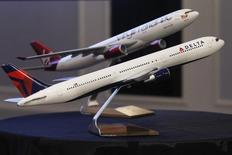 Aircraft models are seen following a news conference to announce the sale of Virgin Atlantic airline to Delta Air Lines, in New York December 11, 2012.  REUTERS/Brendan McDermid