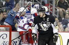 May 13, 2014; Pittsburgh, PA, USA; Pittsburgh Penguins center Sidney Crosby (87) reacts as the New York Rangers celebrate a goal by Rangers center Brian Boyle (not pictured) during the first period in game seven of the second round of the 2014 Stanley Cup Playoffs at the CONSOL Energy Center. Mandatory Credit: Charles LeClaire-USA TODAY Sports
