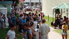 People gather outside an office of the Russian federal migration service in Belgorod in this June 9, 2014 file photo.    REUTERS/Vladimir Kornev/Files
