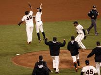 Oct 7, 2014; San Francisco, CA, USA; San Francisco Giants players including Pablo Sandoval (48) and Brandon Belt (second from left) celebrate on the mound after defeating the Washington Nationals in game four of the 2014 NLDS baseball playoff game at AT&T Park. Kelley L Cox-USA TODAY Sports