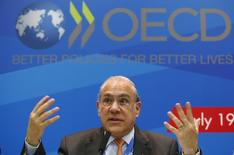 Angel Gurria, secretary-general of the Organisation for Economic Co-operation and Development (OECD), gestures during a news conference, part of the G20 finance ministers and central bank governors' meeting, in Moscow, July 19, 2013.  REUTERS/Grigory Dukor