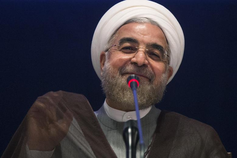 Iran's President Hassan Rouhani smiles while replying to a question during a news conference on the sidelines of the 69th United Nations General Assembly at United Nations Headquarters in New York September 26, 2014.   REUTERS/Adrees Latif
